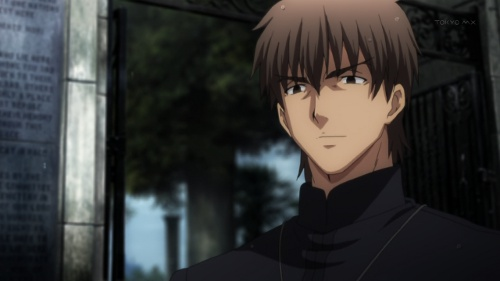 A picture of Kirei Kotomine smirking.